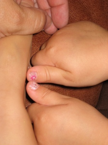 She chose a pale pink shade with glitter and then got little flowers painted on her thumbs.